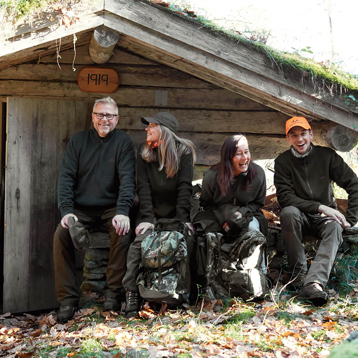 Swedteam hunters outside a hunting lodge
