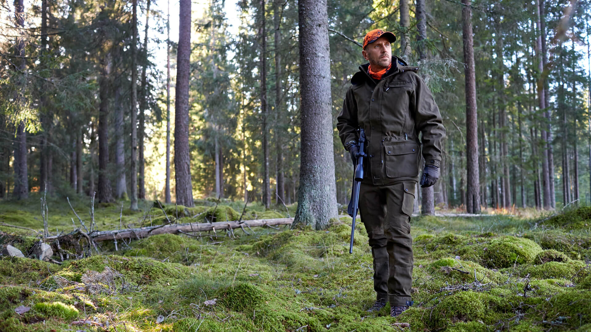 Hunter in the forest on big game hunting